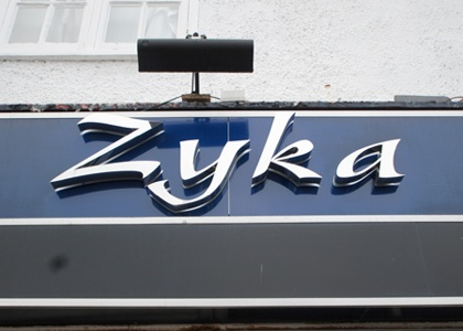 zyka shop sign